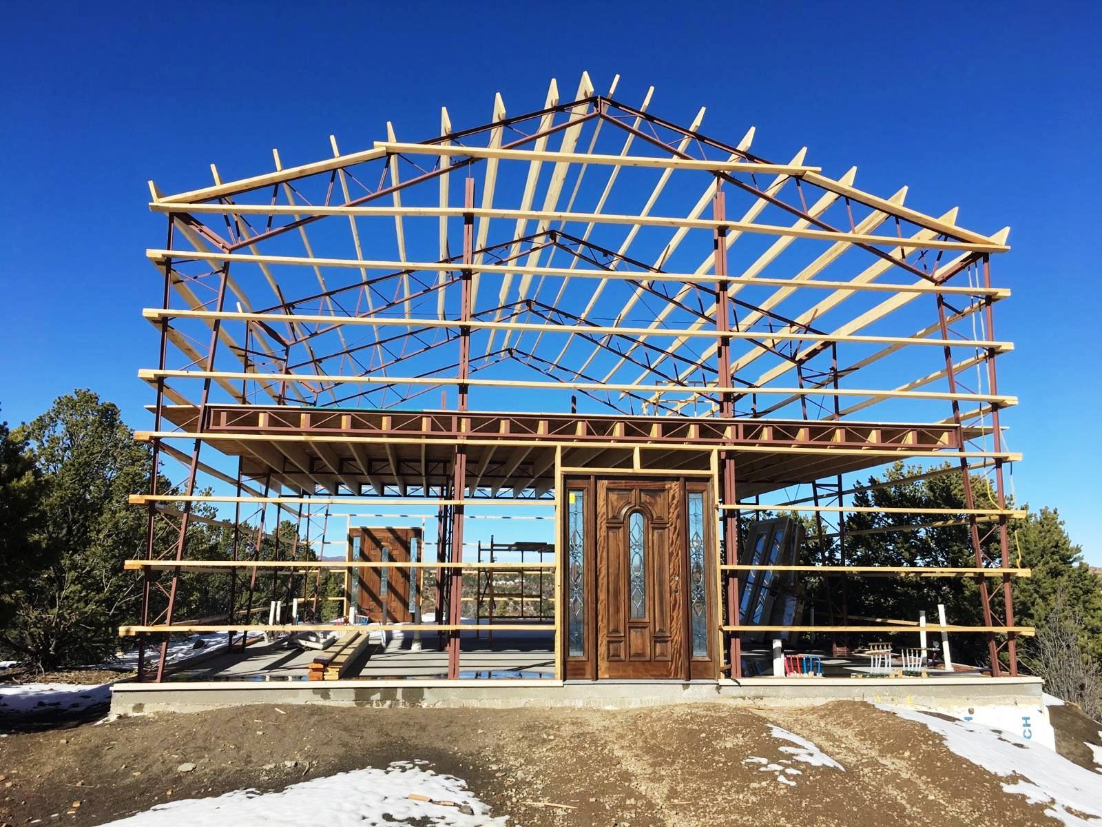 framework of a barn using steel trusses